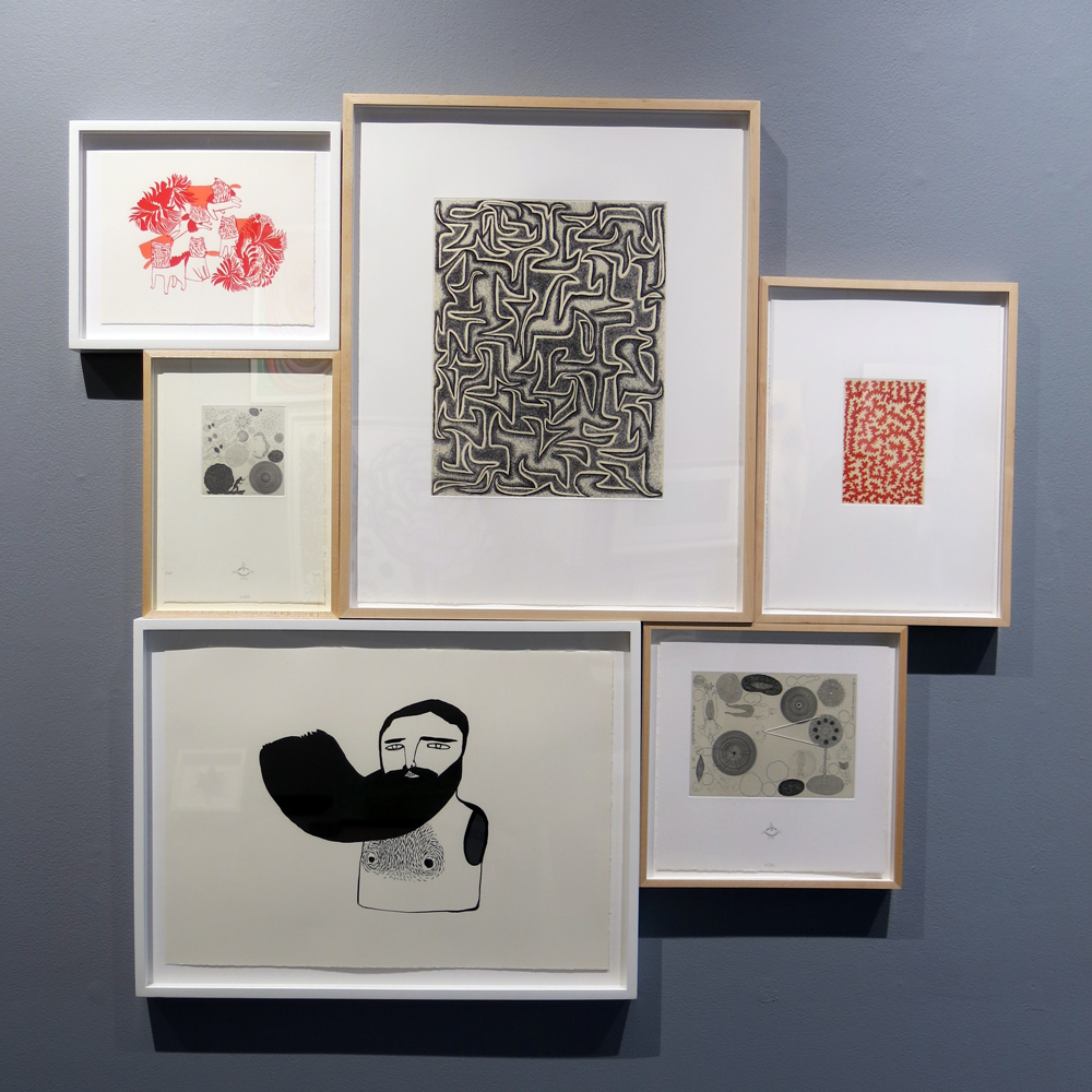Prints by various artists, including James Siena, top center and top right.